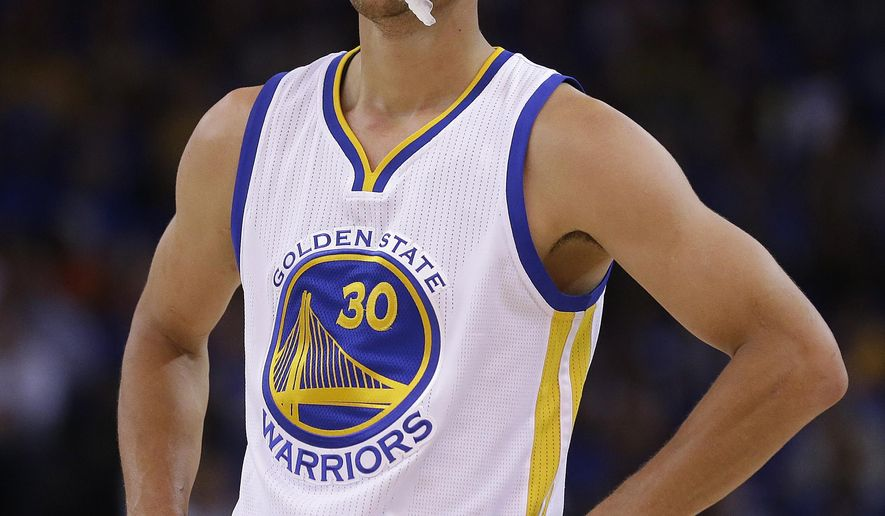 Golden State Warriors' Stephen Curry waits for play to resume during a timeout in the first half of an NBA basketball game against the Denver Nuggets Wednesday, April 15, 2015, in Oakland, Calif. (AP Photo/Ben Margot)