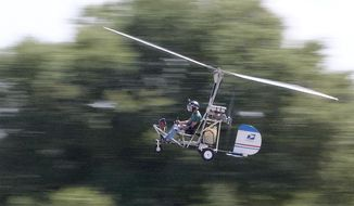 In this March, 2015, photo, Doug Hughes flies his gyrocopter near the Wauchula Municipal Airport in Wauchula, Fla. Police didn't immediately identify the man who steered his one-person helicopter onto the West Lawn of the U.S. Capitol, but Hughes, a Florida postal carrier, took responsibility for the stunt on a website. (James Borchuck/The Tampa Bay Times via AP)