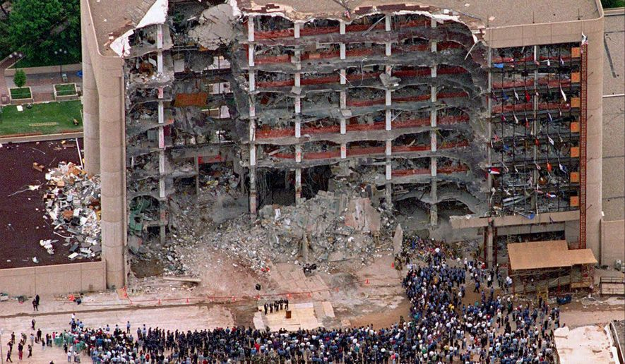 FILE - In this May 5, 1995 file photo, a large group of search and rescue crew attends a memorial service in front of the Alfred P. Murrah Federal Building in Oklahoma City. The blast killed 168 people _ including 19 children _ injured hundreds more and caused hundreds of millions of dollars in damage to structures and vehicles in the downtown area. (AP Photo/Bill Waugh, Flle)
