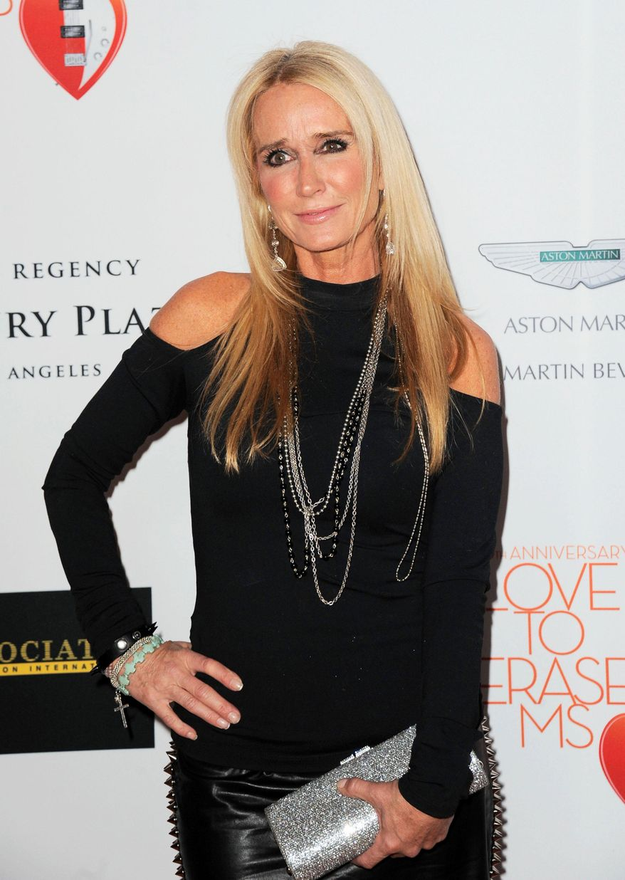 """TV personality Kim Richards arrives at the 20th annual Race to Erase MS event""""Love to Erase MS"""" in Los Angeles in this May 3, 2013, file photo. Richards, one of the Bravo series, """"Real Housewives of Beverly Hills,"""" was arrested Thursday, April 16, 2015, on suspicion of being drunk in public. (Photo by Jordan Strauss/Invision/AP, File)"""