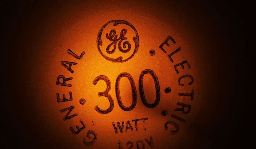 In this photo taken Jan. 14, 2011, a General Electric light bulb glows as it is turned off in Buffalo, N.Y. (AP Photo/David Duprey, File)