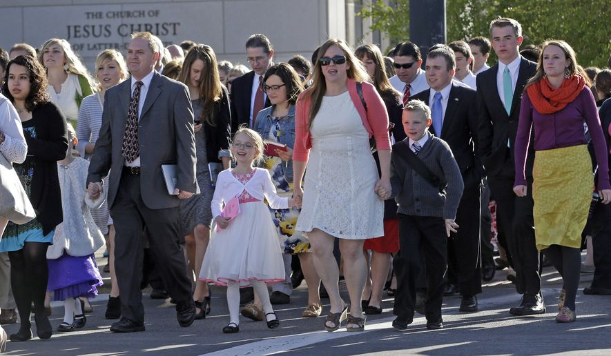 People walk to the Conference Center during opening session of the two-day Mormon church conference Saturday, April 4, 2015, in Salt Lake City. Mormon leaders once again used their biannual conference Saturday to outline the faith's commitment the belief that marriage is an institution exclusive to a man and a woman. (AP Photo/Rick Bowmer)