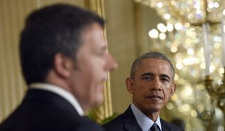 President Barack Obama listens as Italian Prime Minister Matteo Renzi speaks during their joint news conference in the East Room of the White House in Washington, Friday, April 17, 2015. The leaders discussed Europe's economy, a pending trade pact between the U.S. and Europe, climate change and energy security.(AP Photo/Susan Walsh)