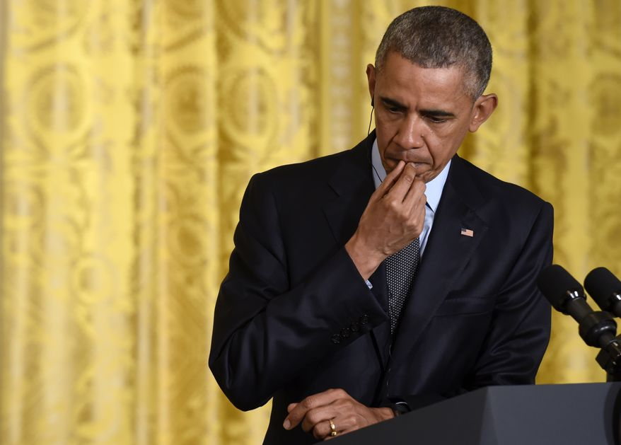 President Barack Obama listened as Italian Prime Minister Matteo Renzi speaks during their news conference in the East Room of the White House in Washington, Friday, April 17, 2015. The leaders discussed Europe's economy, a pending trade pact between the U.S. and Europe, climate change and energy security.(AP Photo/Susan Walsh)