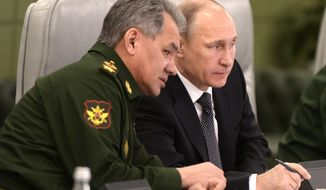 Russian President Vladimir Putin, right, speaks with Defense Minister Sergei Shoigu as he visits the National Defense Control Center in Moscow, Russia, Friday, April 17, 2015. (Alexei Nikolsky/ RIA-Novosti, Kremlin Pool Photo via AP) ** FILE **