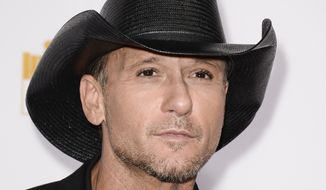 "Singer Tim McGraw arrives at the ""50 Years of Beautiful"" television event celebrating the Sports Illustrated Swimsuit Issue's 50th Anniversary at the Dolby Theatre on in this Jan. 14, 2014, file photo taken in Los Angeles. (Photo by Dan Steinberg/Invision/AP, File)"