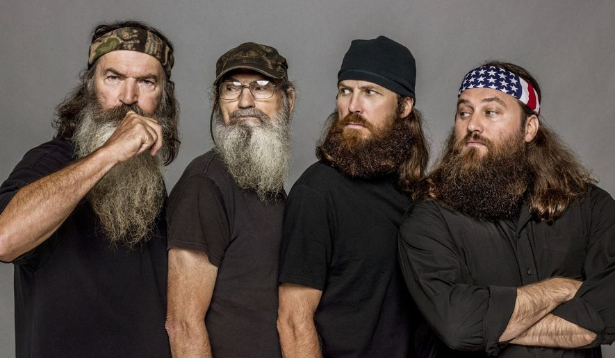 """This undated image released by A&E, shows The Robertsons, from left, Phil, Si, Jase and Willie, from the reality series, """"Duck Dynasty."""" The Las Vegas show """"Duck Commander Musical,"""" based on the popular series, premiered Wednesday, April 15, at the Rio All-Suites Hotel & Casino and tells the story of a family duck-call business that led to reality show juggernaut """"Duck Dynasty."""" (Zach Dilgard/A&E via AP)"""