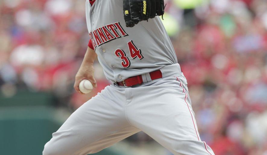 Cincinnati Reds starting pitcher Homer Bailey throws in the first inning of a baseball game against the St. Louis Cardinals, Saturday, April 18, 2015 in St. Louis.(AP Photo/Tom Gannam)