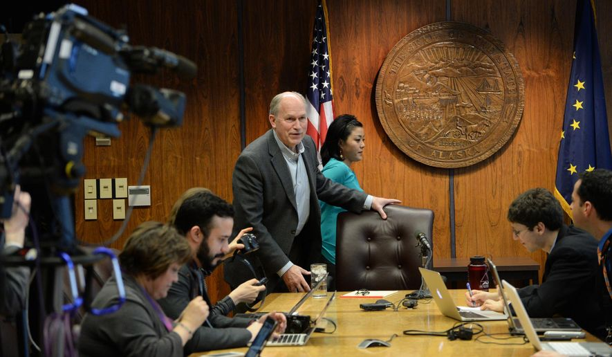 Gov. Bill Walker prepares to take his seat at a press conference Saturday, April 18, 2015, in the Alaska State Capitol. The first session of the 29th Alaska State Legislature is scheduled to finish Sunday night. (Klas Stolpe/The Juneau Empire via AP)