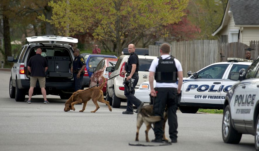 K-9 units are deployed near the scene of an apparent homicide in Fredericksburg, VA, Friday, April 17, 2015. Fredericksburg Police Department Public Information Officer Natatia Bledsoe said Steven Vander Briel, 30,  was arrested Friday after a two-hour search.  Police have charged Vander Briel, 30, with first-degree murder and abduction in the death of Grace Rebecca Mann Friday. (The Free Lance Star, Peter Cihelka via AP)