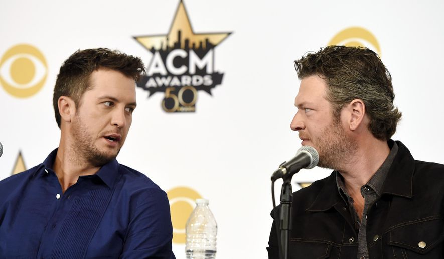 Luke Bryan, left, and Blake Shelton, co-hosts of Sunday's 50th Academy of Country Music Awards, mingle onstage during a news conference on the event at AT&T Stadium on Friday, April 17, 2015, in Arlington, Texas. (Photo by Chris Pizzello/Invision/AP)