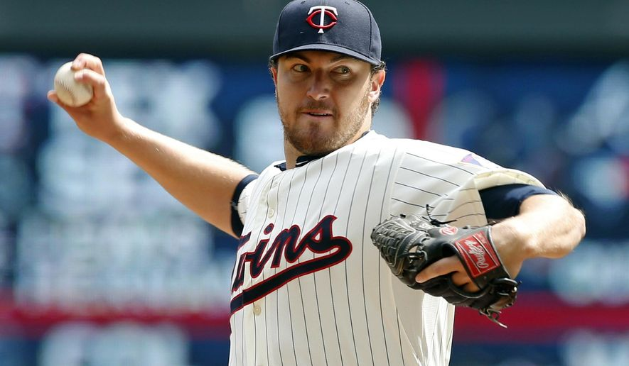 Minnesota Twins pitcher Phil Hughes throws against the Cleveland Indians in the first inning of a baseball game, Saturday, April 18, 2015, in Minneapolis. (AP Photo/Jim Mone)