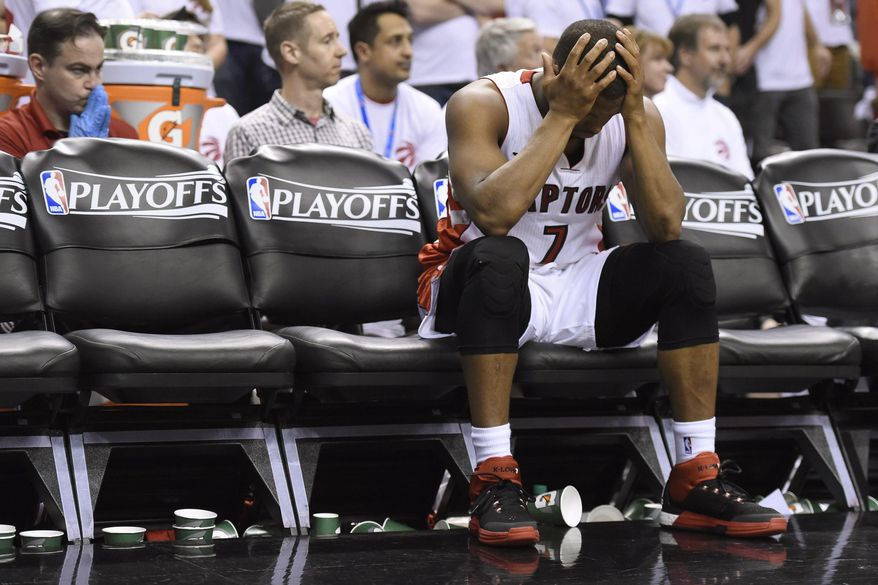 Toronto Raptors' Kyle Lowry (7) sits on the bench after fouling out of the game against the Washington Wizards during NBA playoff action in Toronto on Saturday, April 18, 2015. (Frank Gunn/The Canadian Press via AP)   MANDATORY CREDIT