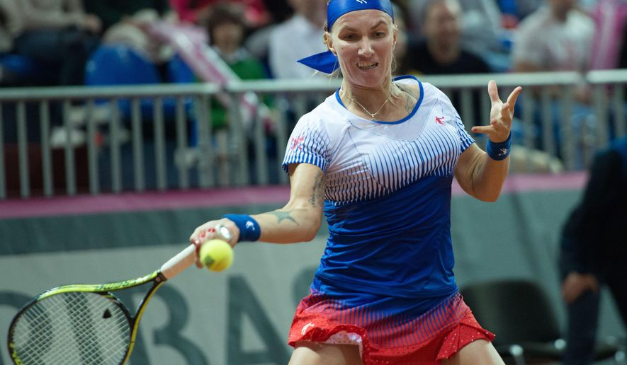 Svetlana Kuznetsova of Russia returns a shot to Julia Goerges of Germany  during their Fed Cup semifinal tennis match in Sochi, Russia, Saturday, April 18, 2015. Svetlana Kuznetsova gave Russia a 1-0 lead over Germany in the Fed Cup World Group semifinals Saturday, beating Julia Goerges in straight sets. (AP Photo/Artur Lebedev)