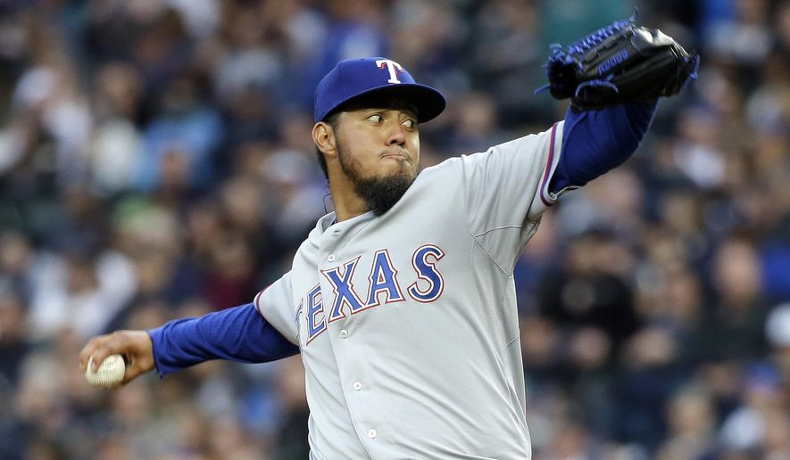 Texas Rangers starting pitcher Yovani Gallardo throws against the Seattle Mariners during the first inning of a baseball game Friday, April 17, 2015, in Seattle. (AP Photo/Elaine Thompson)