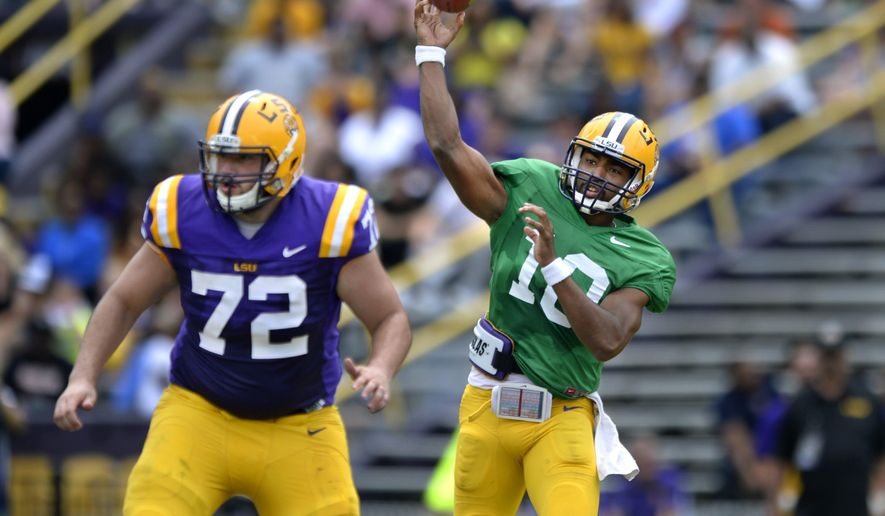 LSU quarterback Anthony Jennings (10) throws downfield, with protection from center Andy Dodd (72),  during the NCAA college football team's spring football game Saturday, April 18, 2015, in Baton Rouge, La. (Travis Spradling/The Baton Rouge Advocate via AP)
