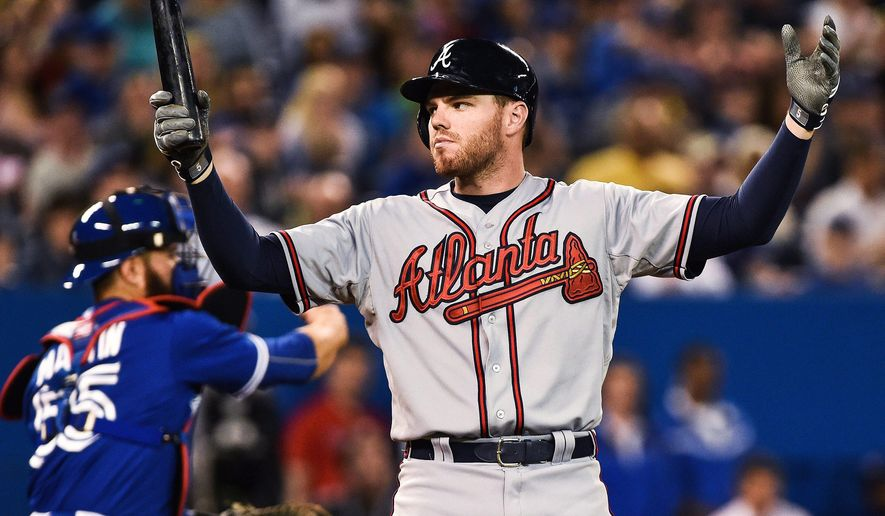 Atlanta Braves; Freddie Freeman reacts after striking out in the 10th inning of a baseball game against the Toronto Blue Jays in Toronto, Saturday, April 18, 2015. (Aaron Vincent Elkaim/The Canadian Press via AP)   MANDATORY CREDIT