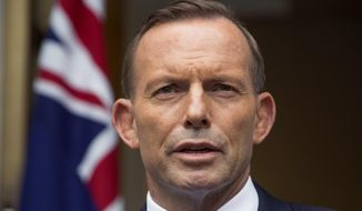 Australian Prime Minister Tony Abbott answers questions at a media conference before attending the parliament's question time in Canberra, in this Feb. 9, 2015. (Associated Press) ** FILE **