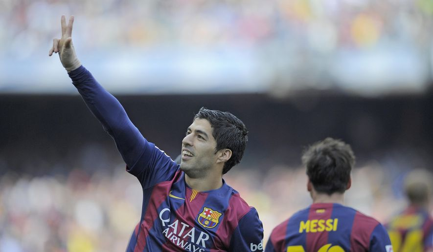 FC Barcelona's Luis Suarez reacts after scoring against Valencia during a Spanish La Liga soccer match at the Camp Nou stadium in Barcelona, Spain, Saturday, April 18, 2015. (AP Photo/Manu Fernandez)