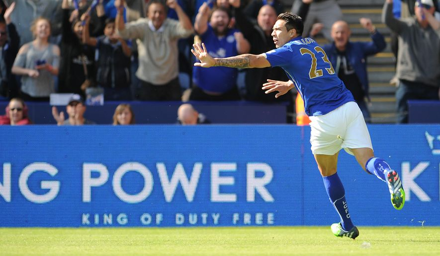 Leicester City's Leonardo Ulloa celebrates his goal against Swansea City during their English Premier League soccer match at the King Power Stadium, Leicester, England, Saturday, April 18, 2015. (Ryan Browne/PA via AP)     UNITED KINGDOM OUT      -    NO SALES      -     NO ARCHIVES