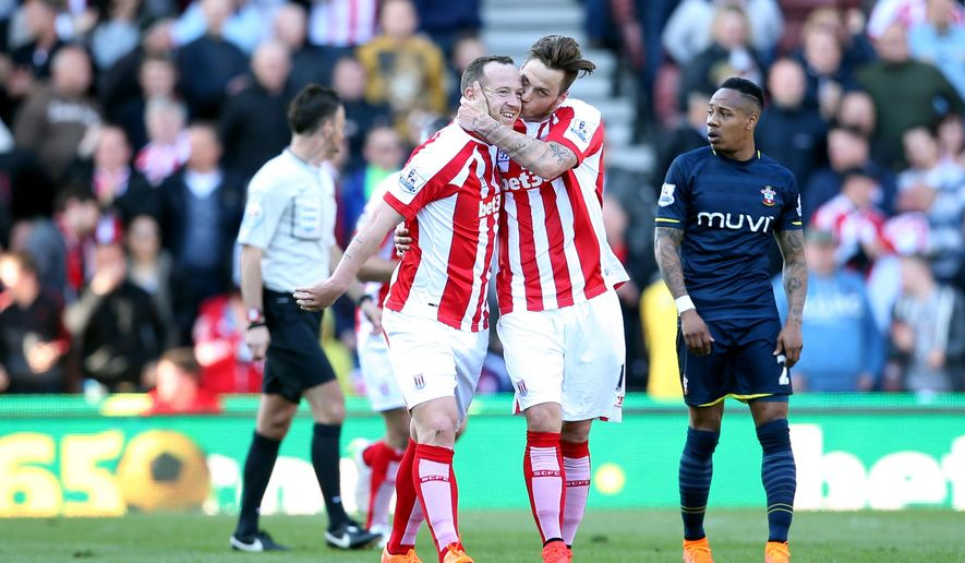 Stoke City's Charlie Adam, left, celebrates scoring his side's second goal of the game against Southampton with teammate Marko Arnautovic during their English Premier League soccer match at the Britannia Stadium, Stoke On Trent, England, Saturday, April 18, 2015. (Lynne Cameron/PA via AP)      UNITED KINGDOM OUT     -     NO SALES     -     NO ARCHIVES