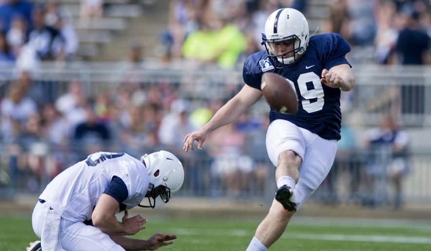 Penn State kicker Joey Julius makes a 55 yard kick before the NCAA college football team's spring football game Saturday, April 18, 2015, in State College, Pa. (Abby Drey/Centre Daily Times via AP) MANDATORY CREDIT; MAGS OUT