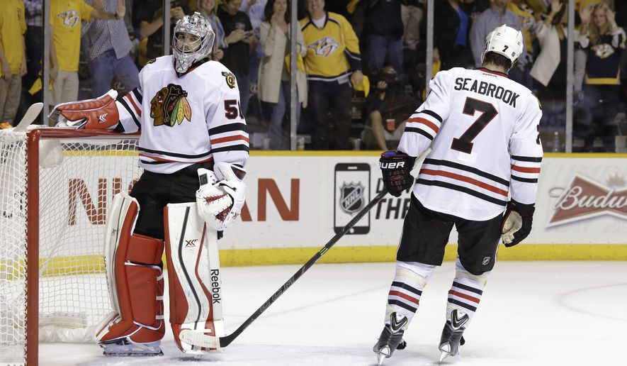 Chicago Blackhawks defenseman Brent Seabrook (7) slaps the leg pad of goalie Corey Crawford (50) after the Nashville Predators scored their sixth goal of the night against Crawford, during the third period of Game 2 of an NHL Western Conference hockey playoff series Friday, April 17, 2015, in Nashville, Tenn. (AP Photo/Mark Humphrey)