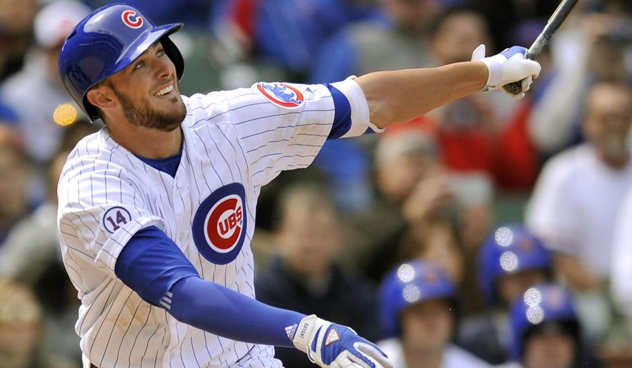 Chicago Cubs' Kris Bryant watches his RBI single during the fifth inning of an MLB baseball game against the San Diego Padres Saturday, April 18, 2015, in Chicago. Bryant's single was his first major league hit. (AP Photo/Paul Beaty)
