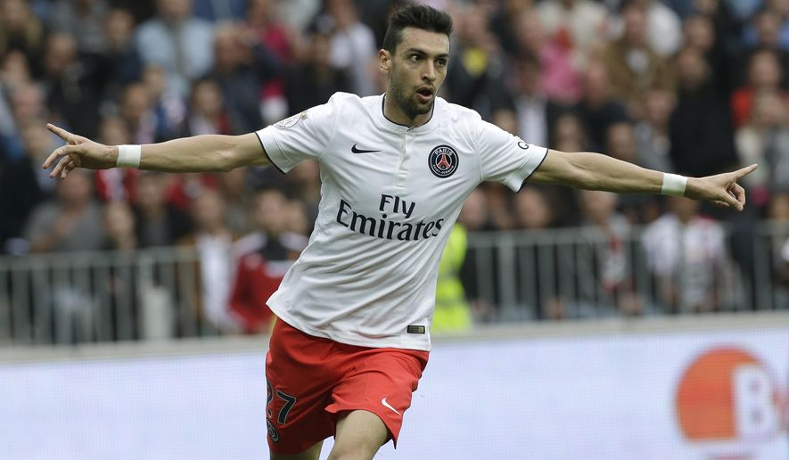 PSG's Javier Pastore reacts after scoring the first goal against Nice in their French League One soccer match, Saturday, April 18, 2015, in Nice stadium, southeastern France. (AP Photo/Lionel Cironneau)