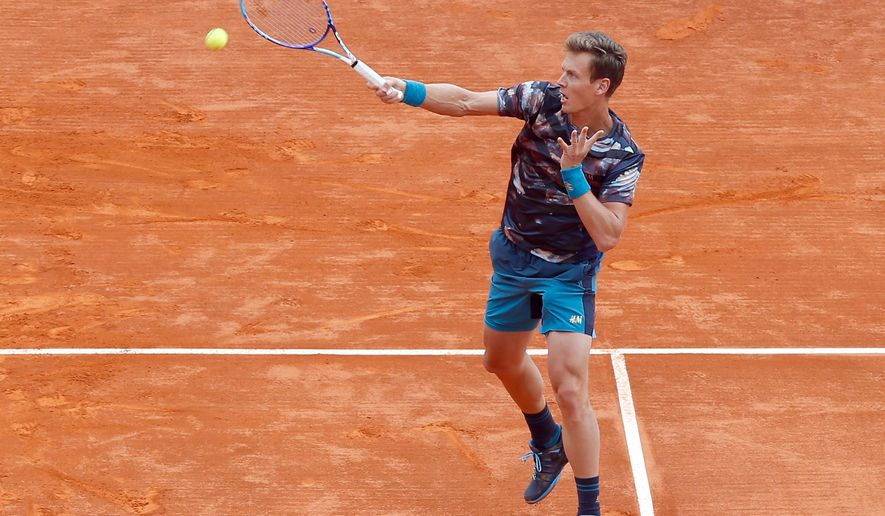 Tomas Berdych of Czech Republic plays a return to Gael Monfils of France, during their semifinal match of the Monte Carlo Tennis Masters tournament, in Monaco, Saturday, April 18, 2015. (AP Photo/Claude Paris)