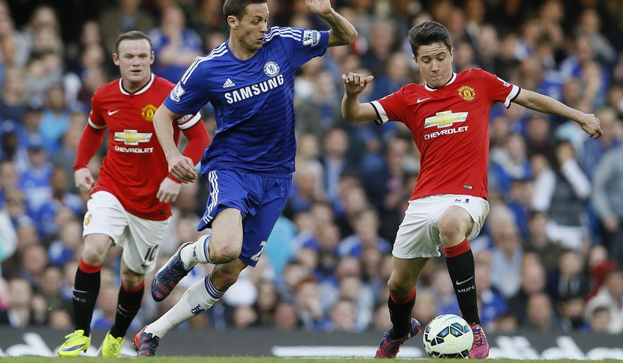 Chelsea's  Nemanja Matic, left, vies for the ball with Manchester United's Ander Herrera during the English Premier League soccer match between Chelsea and Manchester United at Stamford Bridge stadium in London, Saturday, April 18, 2015. (AP Photo/Kirsty Wigglesworth)