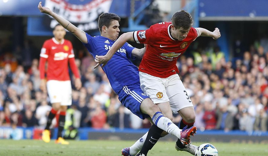 Chelsea's Oscar, left, vies for the ball with Manchester United's Paddy McNair during the English Premier League soccer match between Chelsea and Manchester United at Stamford Bridge stadium in London, Saturday, April 18, 2015. (AP Photo/Kirsty Wigglesworth)