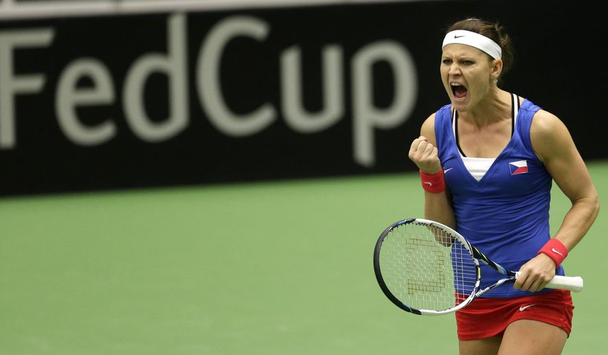 Lucie Safarova from Czech Republic reacts after winning a point against Caroline Garcia from France during a Fed Cup semifinal tennis  match in Ostrava, Czech Republic, Saturday, April 18, 2015. (AP Photo/Petr David Josek)