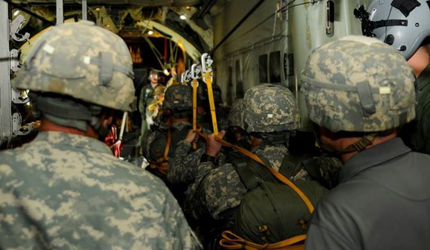 Paratroopers exit a 440th Airlift Wing C-130 Hercules aircraft during an airborne operation above Fort Bragg, N.C., April 9, 2015. (Image: U.S. Army, 82nd Airborne Division, Facebook)