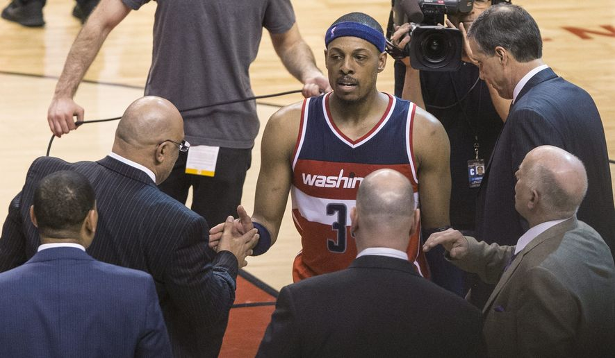 Washington Wizards' Paul Pierce, center, is congratulated after their 93-86 overtime win against the Toronto Raptors in Game 1 in the first round of the NBA basketball playoffs, Saturday, April 18, 2015, in Toronto. (Chris Young/The Canadian Press via AP)   MANDATORY CREDIT