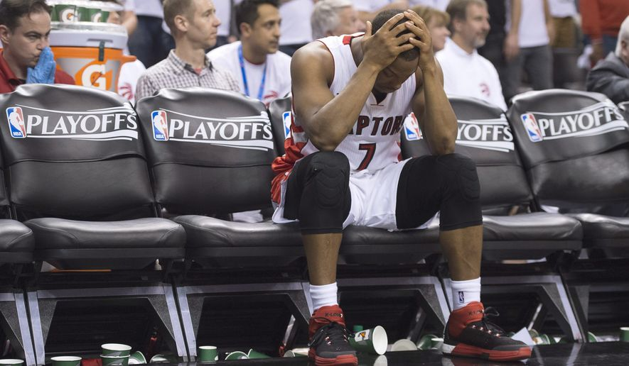 Toronto Raptors' Kyle Lowry sits on the bench after fouling out of the game during fourth quarter against the Washington Wizards in Game 1 in the first round of the NBA basketball playoffs, Saturday, April 18, 2015,  in Toronto. The Wizards won 93-86 in overtime. (Frank Gunn/The Canadian Press via AP)   MANDATORY CREDIT