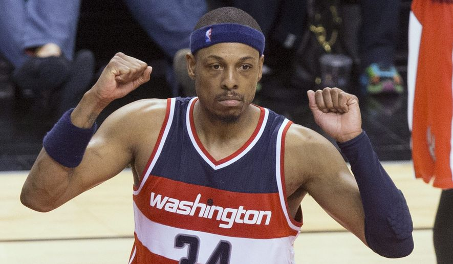 Washington Wizards' Paul Pierce (34) and Otto Porter react during overtime in Game 1 in the first round of the NBA basketball playoffs against the Toronto Raptors, Saturday, April 18, 2015,  in Toronto. The Wizards won 93-86 in overtime. (Chris Young/The Canadian Press via AP)   MANDATORY CREDIT