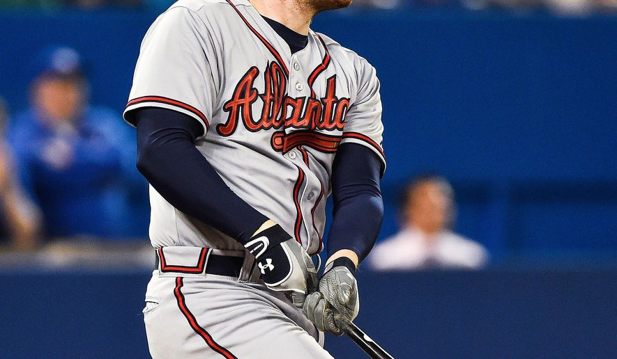 Atlanta Braves' Freddie Freeman watches his two-run home run in the third inning of a baseball game against the Toronto Blue Jays in Toronto, Saturday, April 18, 2015. (Aaron Vincent Elkaim/The Canadian Press via AP)   MANDATORY CREDIT