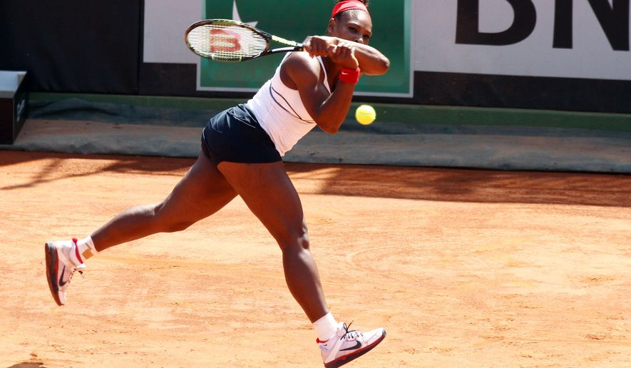 Serena Williams of the United States returns the ball to Italy's Camila Giorgi  during a Fed Cup World Group playoff tennis match in Brindisi, Italy, Saturday, April 18, 2015. (AP Photo/Felice Calabro')