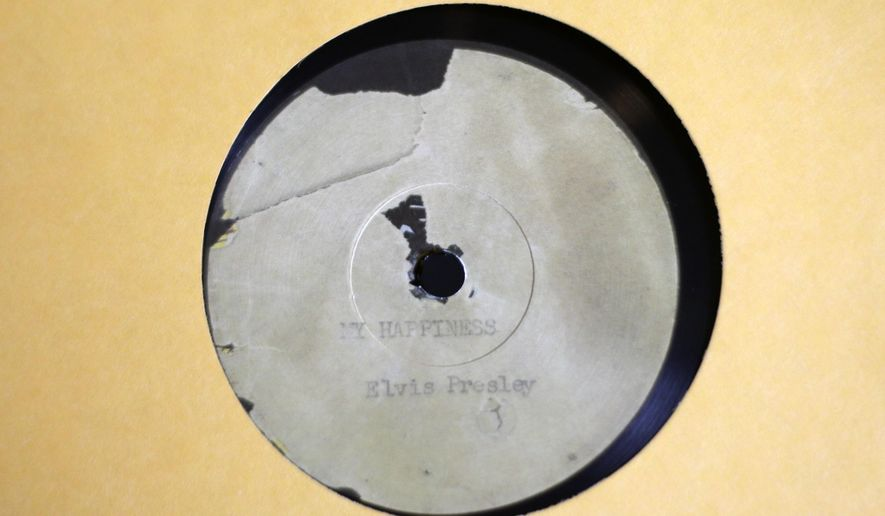 """A 10-inch, 78-rpm copy of Elvis Presley's original recording of """"My Happiness"""" and """"That's When Your Heartaches Begin"""" is shown at Jack White's Third Man Records on Record Store Day Saturday, April 18, 2015, in Nashville, Tenn. The facsimile of the recording, with all the pops and crackles of the original acetate, is available in the store Saturday only. (AP Photo/Mark Humphrey)"""