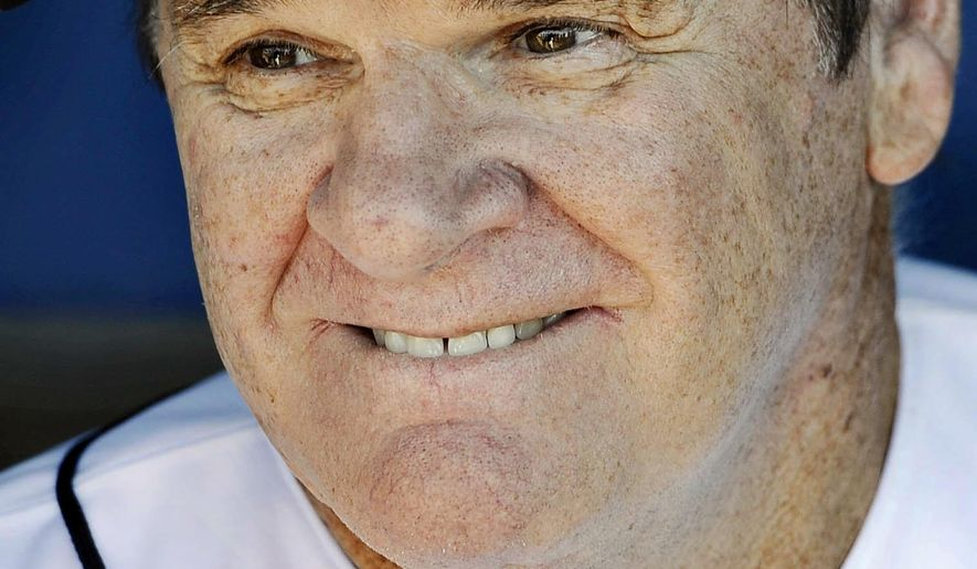 FILE - In hits June 16, 2014, file photo, Pete Rose smiles while sitting in the dugout at The Ballpark at Harbor Yard in Bridgeport, Conn., before he managed the independent minor-league Bridgeport Bluefish in a baseball game. Fox Sports said Saturday, April 18, 2015, that it was hiring Rose, the career hits leader, as a special guest analyst. Rose agreed to the lifetime ban from baseball in August 1989 after a Major League Baseball investigation concluded he bet on the Cincinnati Reds to win while managing the team. (AP Photo/Jessica Hill, File)