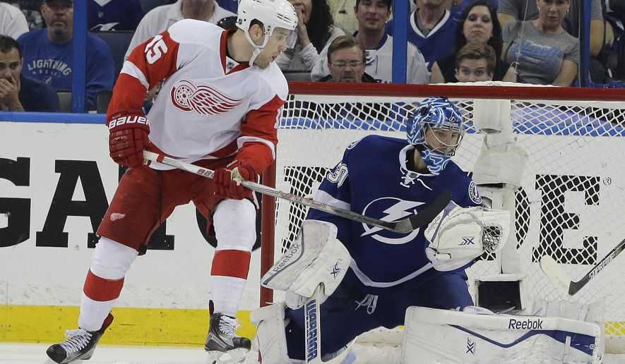 Tampa Bay Lightning goalie Ben Bishop (30) makes a glove save on a shot by Detroit Red Wings center Riley Sheahan (15) during the second period of Game 2 of a first-round NHL Stanley Cup hockey playoff series Saturday, April 18, 2015, in Tampa, Fla. (AP Photo/Chris O'Meara)