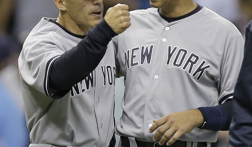 New York Yankees' Alex Rodriguez, left, celebrates with manager Joe Girardi after the Yankees defeated the Tampa Bay Rays 5-4 during a baseball game Friday, April 17, 2015, in St. Petersburg, Fla. (AP Photo/Chris O'Meara)