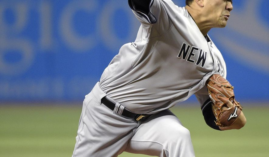 New York Yankees starting pitcher Masahiro Tanaka, of Japan, throws a pitch to home plate during the first inning of a baseball game against the Tampa Bay Rays in St. Petersburg, Fla., Saturday, April 18, 2015.(AP Photo/Phelan M. Ebenhack)