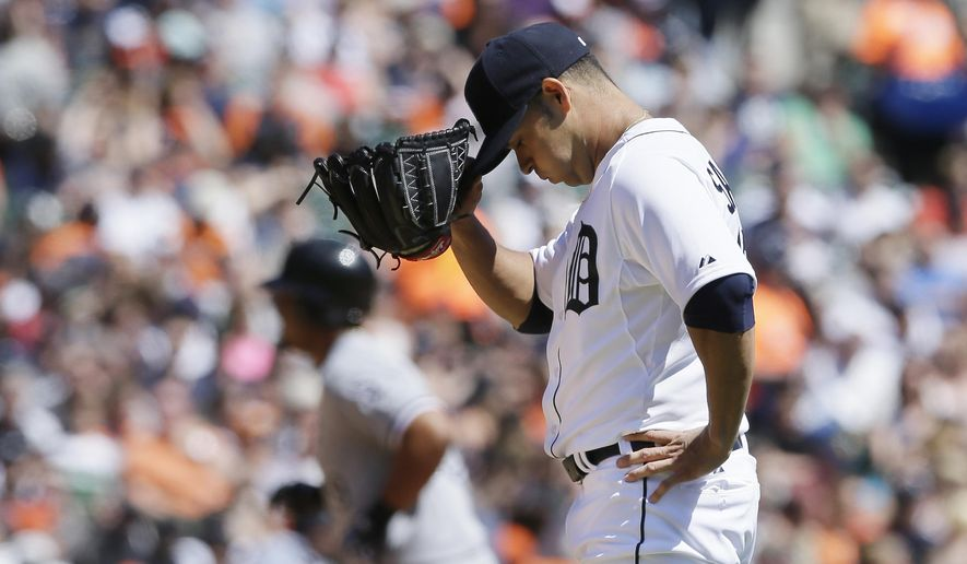 Detroit Tigers starting pitcher Anibal Sanchez reacts as Chicago White Sox's Jose Abreu, background, runs the bases after hitting a grand slam during the fourth inning of a baseball game, Saturday, April 18, 2015, in Detroit. (AP Photo/Carlos Osorio)