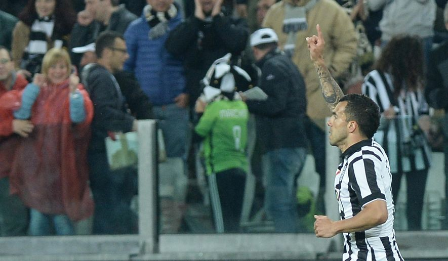 Juventus' Carlos Tevez celebrates after scoring during a Serie A soccer match between Juventus and Lazio at the Juventus stadium, in Turin, Italy, Saturday, April 18, 2015. (AP Photo/Massimo Pinca)