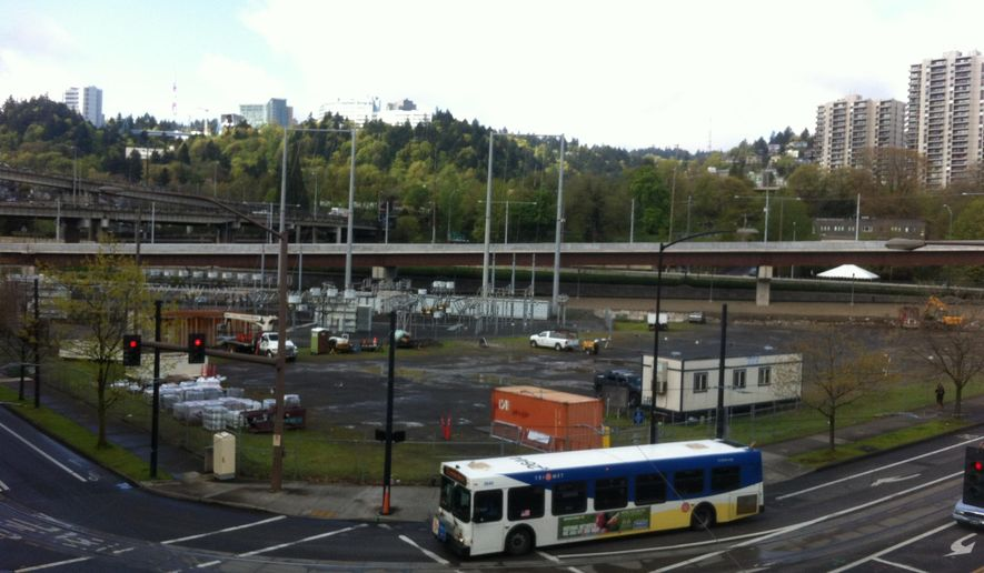 """This April 14, 2015, photo shows land that the city of Portland wants to develop affordable housing in RiverPlace on the edge of Portland's South Waterfront District in Portland, Ore. Acknowledging that Portland's poorest residents have dwindling options to live in good neighborhoods, local housing officials have hatched a plan to open 500 units in so-called """"opportunity"""" areas. (Brad Schmidt/The Oregonian via AP) MAGS OUT; TV OUT; NO LOCAL INTERNET; THE MERCURY OUT; WILLAMETTE WEEK OUT; PAMPLIN MEDIA GROUP OUT"""