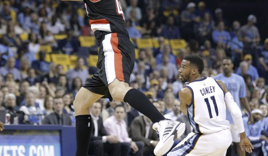 Portland Trail Blazers center Robin Lopez, left, steals a pass intended for Memphis Grizzlies guard Mike Conley (11) in the first half of Game 1 of an NBA basketball Western Conference playoff series, Sunday, April 19, 2015, in Memphis, Tenn. (AP Photo/Mark Humphrey)