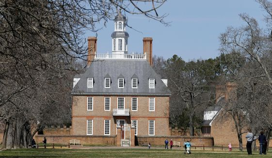 In this photo taken March 18, 2015, visitors walk to the Governors palace along Duke of Gloucester street in the Colonial Williamsburg area of Williamsburg, Va.,  John Hinckley, the last man to shoot an American president now spends most of the year in a house overlooking the 13th hole of a golf course in a gated community in Williamsburg. An almost three-hour drive south of Hinckley's institutional home of St. Elizabeths Hospital in the nation's capital, Williamsburg is both a tourist destination and a retirement mecca.  (AP Photo/ Steve Helber)