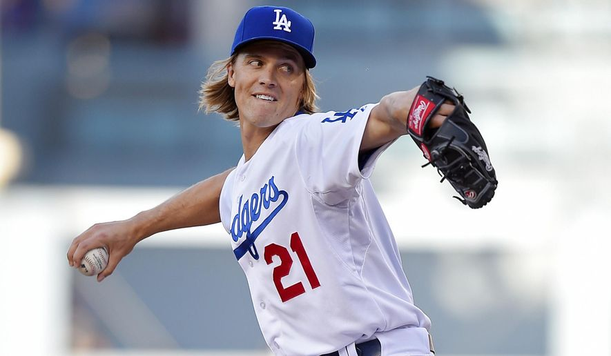 Los Angeles Dodgers starting pitcher Zack Greinke throws to the plate during the first inning of a baseball game against the Colorado Rockies, Saturday, April 18, 2015, in Los Angeles. (AP Photo/Mark J. Terrill)